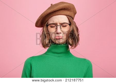Dismal Gloomy Rejected Young Female Has Problems And Difficulties, Curves Lower Lip And Closes Eyes