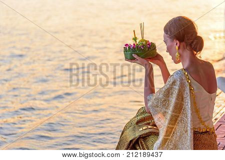 A woman ready to Loy Kratong Festival at  Waterfront