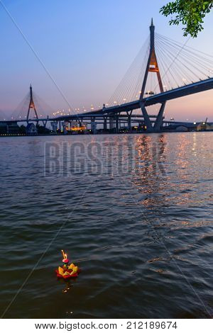 Loy Kratong Festival at Wat Darn Temple Waterfront and big bridge on background