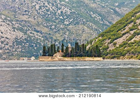 Saint George Benedictian monastery on St. George island Ostrvo Sveti Dorde. One of the two islets near coast of Perast town at Kotor bay. Montenegro.