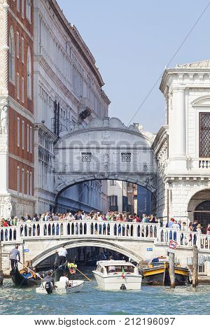 VENICE ITALY - SEPTEMBER 22 2017: Sea view on stone bridge Ponte della Paglia and Bridge of Sighs.The bridge is always surrounded by tourists with the best view of the Bridge of Sighs