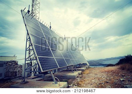 photovoltaic panel in front of cloudy sky