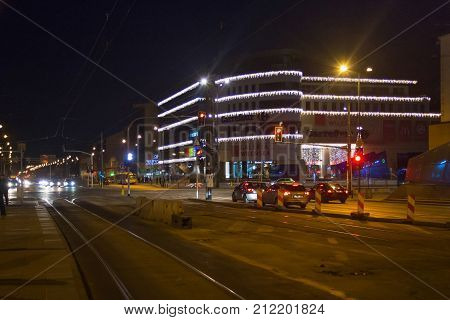WARSAW, POLAND - DECEMBER 31, 2015: View to the shopping center Galeria Wilenska in the Northern Praga district at night. In the building of the center also located retail hypermarket Carrefour.