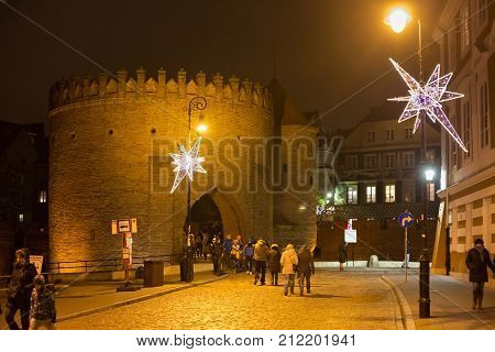 WARSAW, POLAND - JANUARY 01, 2016: Night view of the Warsaw Barbican. Is a fortified outpost and one of few remaining relics of the complex network of historic fortifications that once encircled city