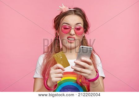 Cute Lovely Young Gorgeous Female In Trendy Clothes Transfers Money Through Modern Mobile Payment Ap
