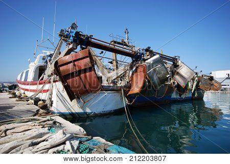 CALETA DE VELEZ, SPAIN - OCTOBER 27, 2008 - Fishing trawlers moored alongside the quay in the harbour Caleta de Velez Malaga Province Andalusia Spain Western Europe, October 27, 2008.