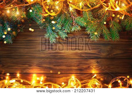 Christmas background, a table decorated with Christmas garland and fir branches. Happy New Year and Merry Christmas. Background with copy space.
