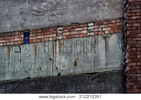 Combined brick concrete wall. Grunge wall. Grey wall. Concrete wall. Brick wall. Grey wall. Grunge style.