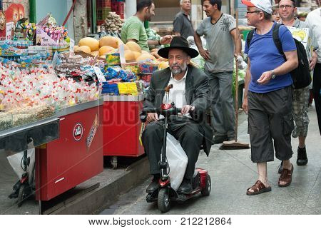 Undefined Disabled Orthodox Jewish Man Move On Electric Wheelchair At Mahane Yehuda Market, Jerusale