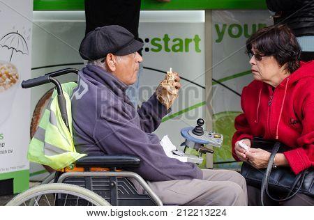 Undefined Disabled Man On Wheelchair Eat Sandwich At Mahane Yehuda Market, Jerusalem, Israel