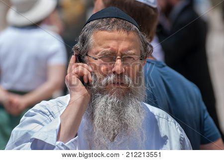Orthodox Jewish Man Speak On His Mobile Phone Near The Western Wall. Jerusalem. Israel