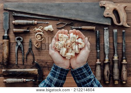 Carpenter Holding Wood Shavings