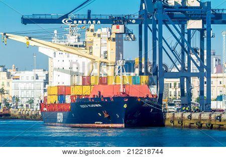CADIZ SPAIN - JUN 04: Cargo ship Fesco Vladimir Mediterranea downloading at the harbor of Cadiz on Jun 04 2012 in Cadiz Spain