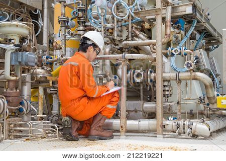 Mechanical inspector inspection on gas turbine compressor to find an abnormal condition while compressor is running. Offshore oil and gas industry maintenance activities.