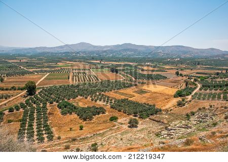 Gardens and fields on plateau among mountains on Crete Greece