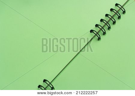 Binding of notepad on a spring close up