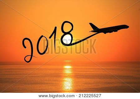 New year 2018 drawing by airplane on the air at sunset