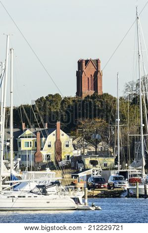 Fairhaven Massachusetts USA - November 4 2017: Tower of First Congregational Church rises above marina on Acushnet River in Fairhaven Massachusetts