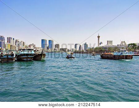Dubai, United Arab Emirates - July 05, 2004: Small and large ships sail on the Dubai Creek in the United Arab Emirates.