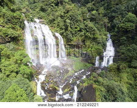 Beautiful waterfall.Tad Khamued Waterfall in southern Laos.It is a place to visit the natural beauty.Mountain forest waterfall landscape.Top viewAerial viewwaterfall amazing nature backgroundRainforest