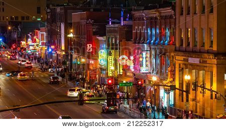 NASHVILLE, TN - OCTOBER 8, 2017: Neon signs light the strip along Broadway in Nashville Tennessee USA
