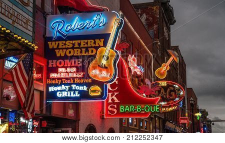 NASHVILLE, TN - OCTOBER 8: Neon signs light the strip along Broadway in Nashville Tennessee USA