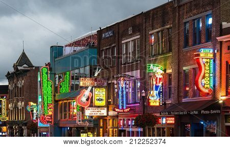 NASHVILLE TN - OCTOBER 8, 2017: Neon signs light the strip along Broadway in Nashville Tennessee USA