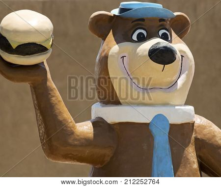 HATCH, NEW MEXICO, JULY 7. Sparkys BBQ and Espresso on July 7, 2017, in Hatch, New Mexico. A Yogi Bear Figure at Sparkys BBQ and Espresso a Roadside Attraction in Hatch in New Mexico.