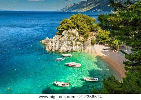 Amazing summer landscape with Adriatic Sea Biokovo mountains and majestic bay Brela beach Makarska riviera Dalmatia Croatia Europe