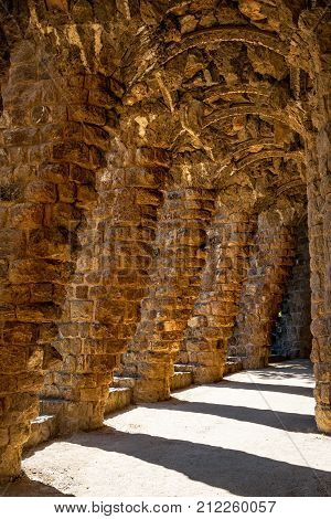 Barcelona Spain - September 24 2015: View of Colonnade by architect Antoni Gaudi at Park Guell in Barcelona