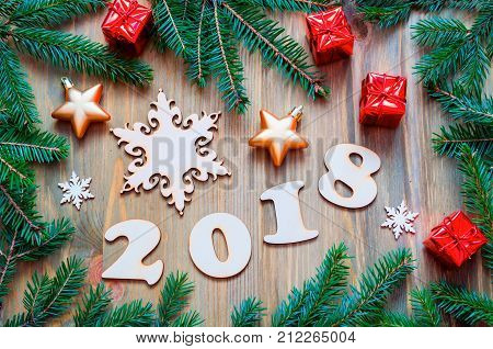 Happy New Year 2018 background with 2018 figures Christmas toys green fir tree branches - New Year 2018 still life. Festive card, New Year 2018 concept. New Year 2018 greeting card