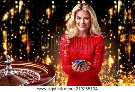 beautiful blonde girl with chips stands on the background of a royal roulette. collage with a gambler, roulette and chips big win