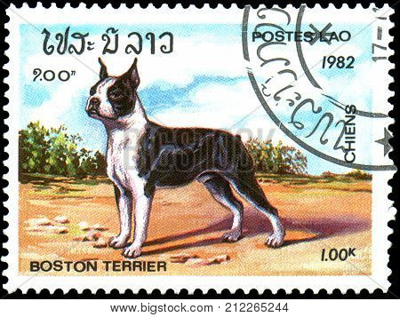 LAOS - CIRCA 1982: a postage stamp, printed in Laos, shows a Boston-Terrier dog