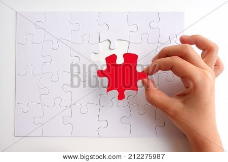 Young Girl Placing The Last Puzzle Piece