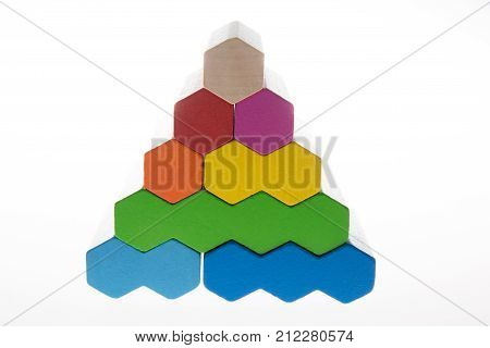 a colorful pyramid in a wooden toy