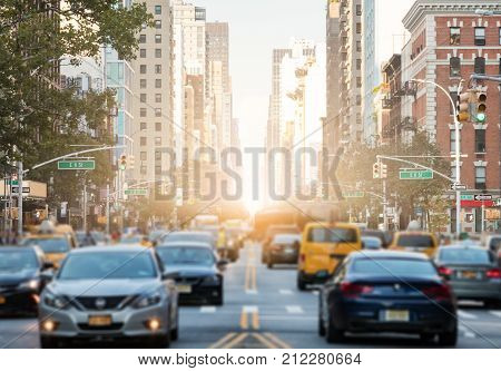 Traffic along 3rd Avenue in Manhattan New York City with Sunlight Background Glow
