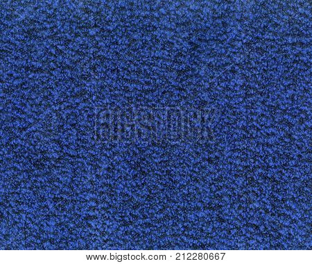 Fragment of bright blue coat fabric with black inclusion. Textured background. Close up shoot.