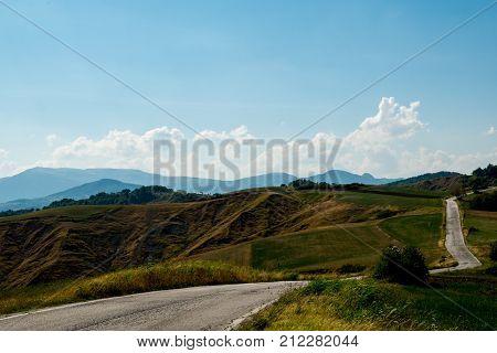 Winding blacktop road through the hills Monte Altavelio Italy