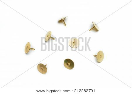 Small Collection Of 4 Brass Thumbtacks On White Background