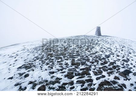 Triangulation station on the summit of Mam Tor in Winter. Peak District Derbyshire UK