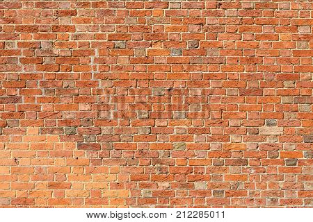 Old traditional reclaimed red brick wall background