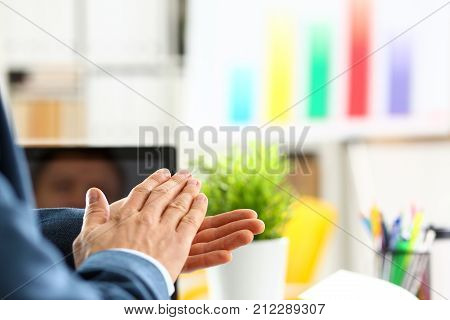 Man in suit clap his arms congrats for successful seminar in office closeup. Thank symbol great lecture job emotion worker introduce colleague negotiation happy birthday win career project idea