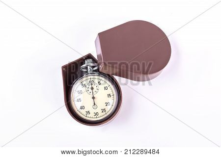Silver stopwatch in box. New mechanical stopwatch in brown box isolated on white background. Metallic stopwatch as gift.