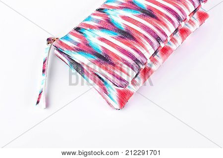 Pink patterned cosmetics bag. Glamorous cosmetics bag with a zipper isolated on white background.