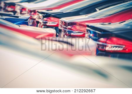 Car Business Concept. Car Dealership Parking Lot. Brand New Vehicles in Stock Awaiting Clients.