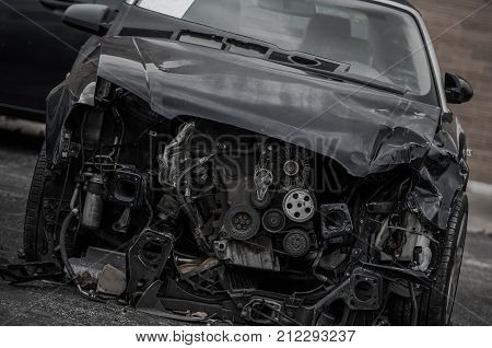 Head On Collision Wreck. Crashed Modern Compact Vehicle. Heavy Front Damage.