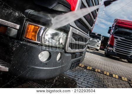 Semi Truck Tractor Washing by High Pressured Water. Keeping Trucks Clean.