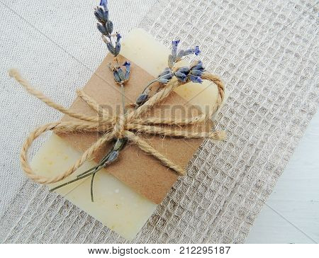 Handmade spa lavender soap on handmade waffle linen towel background. Soap making. Soap bars. Spa, skin care.