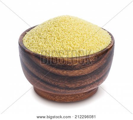 Couscous in wooden bowl isolated on white background. One of the collection