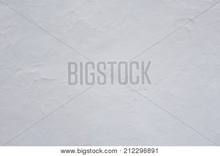 Clay wall is whitewashed by lime textured background